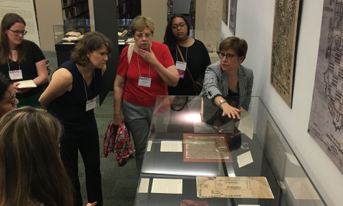 LAL Director Hortensia Calvo giving a tour of the library's Colonial Counterpoint exhibit (2018).