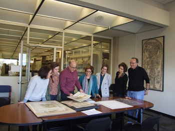 Image of family donating rare maps to the Latin American Library
