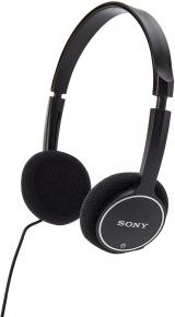 a pair of black Sony headphones hovering against a white background.